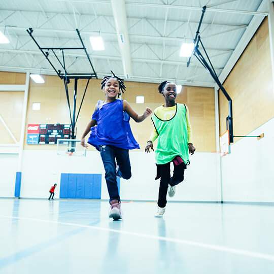 BGCMA youth running in the gym