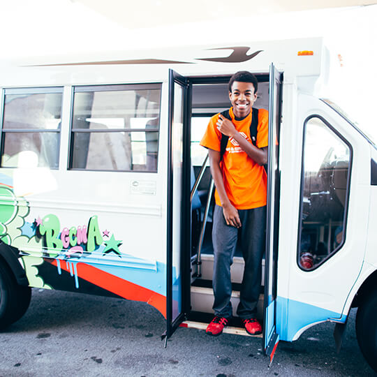 BGCMA youth arriving to the club off the bus