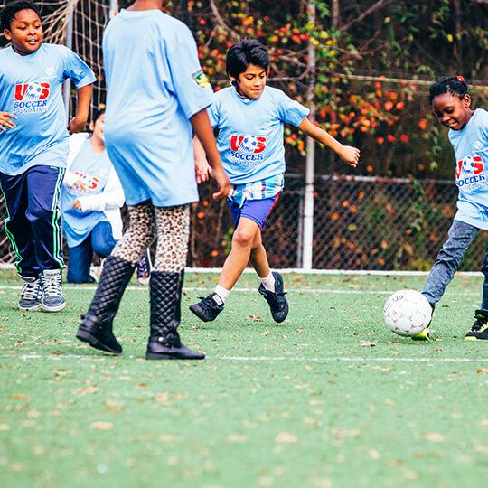 BGCMA youth playing soccer