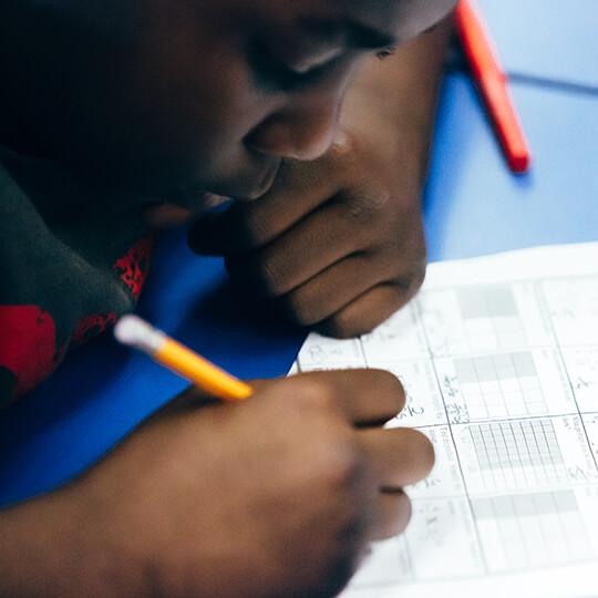 BGCMA youth doing homework